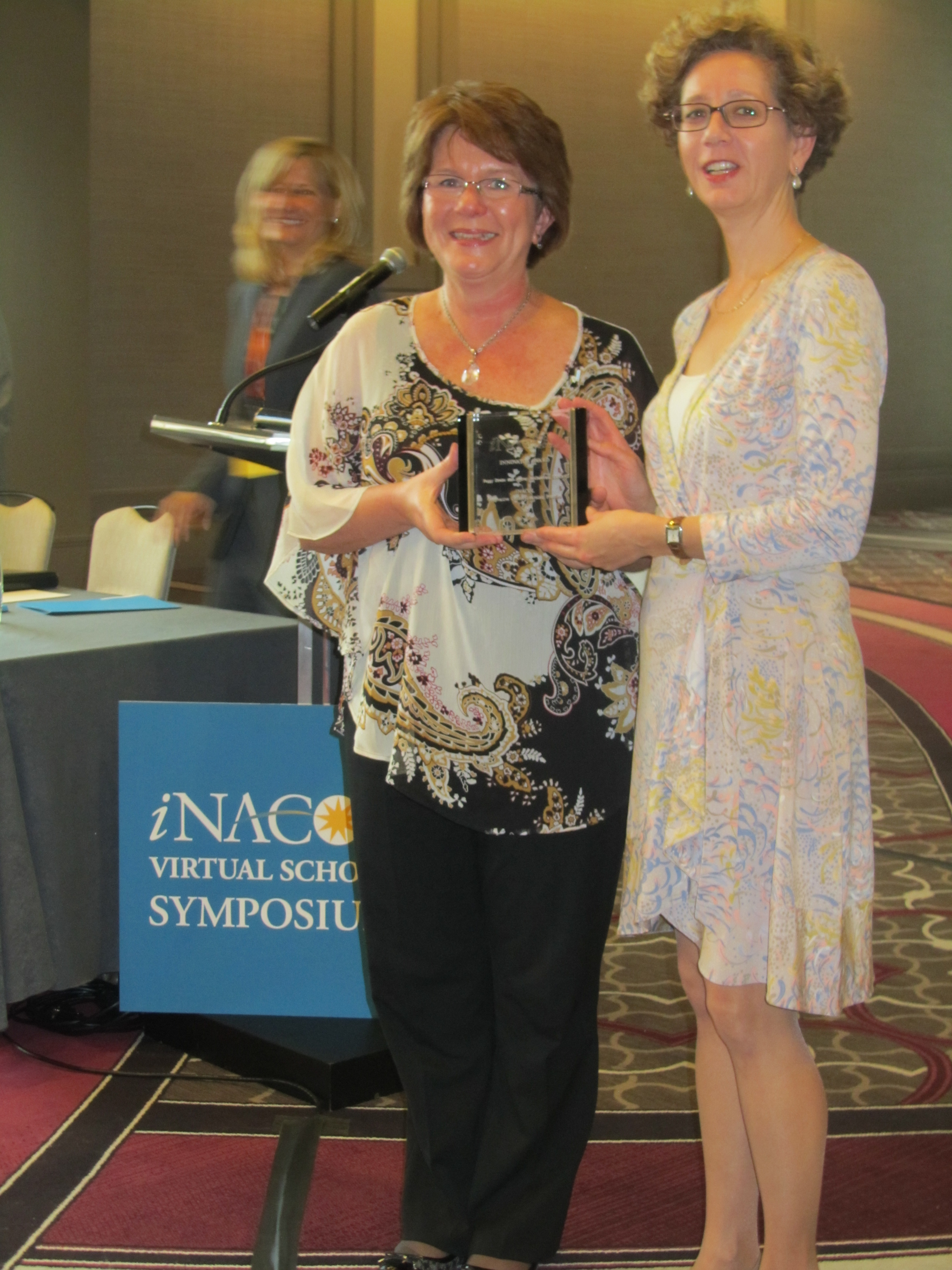 Peggy Drolet and Audrey McGoldrick with iNACOL award